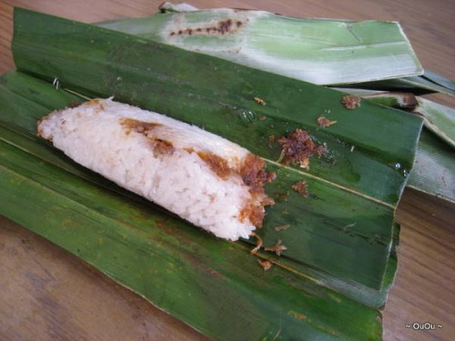 Otak-otak: sticky rice with sambal belachan wrapped in banana leaves. It's spicy!