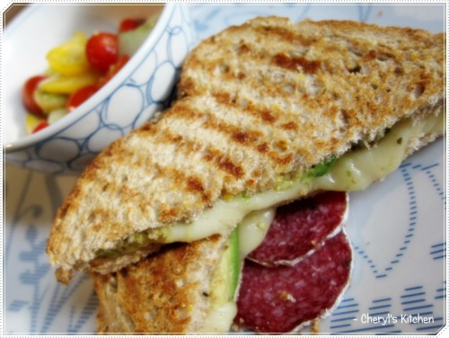 Tomato cucumber salad, cheese panini and of course couple slices of salami. :)