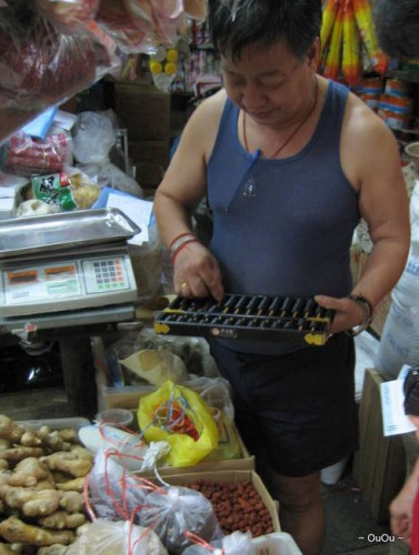 this shop owner uses digital scale and an abacus. :)