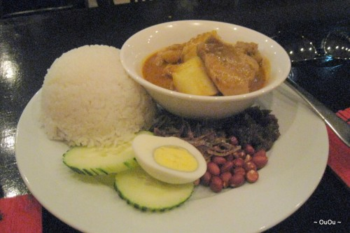 Nasi Lemak (Sambal, anchovy, cucumber, hard-boiled egg, roasted peanuts, served with coconut rice and curry chicken)
