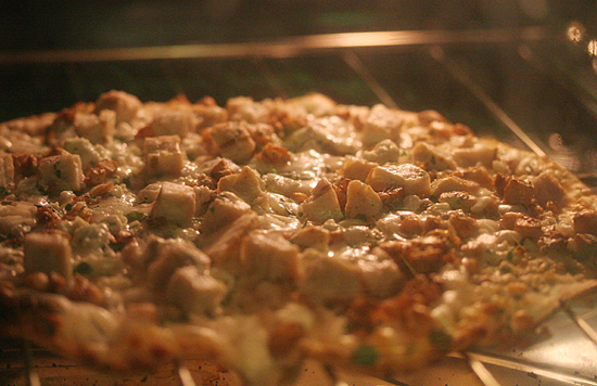 Garlic Chicken Pizza in the Oven... hmm... smells so good